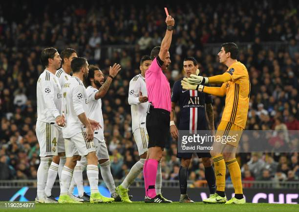 Thibaut Courtois of Real Madrid receives a red card which is rescinded following a VAR review during the UEFA Champions League group A match between...