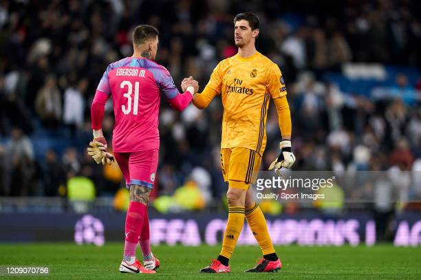 Thibaut Courtois of Real Madrid salutes with Ederson of Manchester City during the UEFA Champions League round of 16 first leg match between Real...