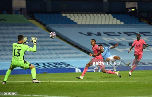 Thibaut Courtois of Real Madrid saves a shot from Gabriel Jesus of Manchester City during the UEFA Champions League round of 16 second leg match...