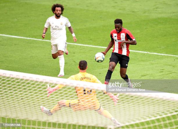 Thibaut Courtois of Real Madrid saves a shot from Inaki Williams of Athletic Club during the La Liga match between Athletic Club and Real Madrid CF...