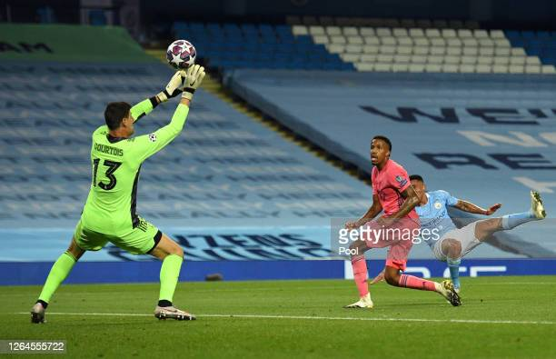 Thibaut Courtois of Real Madrid saves from Gabriel Jesus of Manchester City during the UEFA Champions League round of 16 second leg match between...