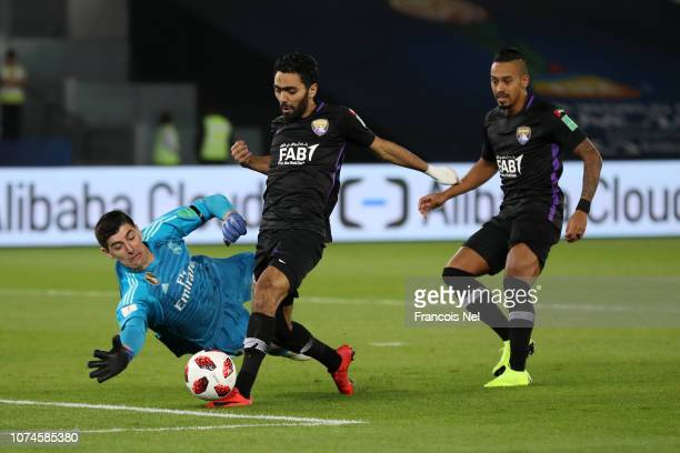 Thibaut Courtois of Real Madrid saves from Hussein El Shahat of Al Ain during the FIFA Club World Cup UAE 2018 Final between Al Ain and Real Madrid...