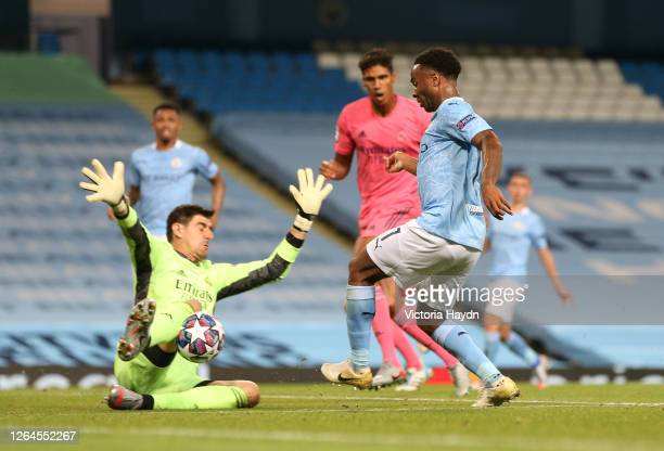 Thibaut Courtois of Real Madrid saves from Raheem Sterling of Manchester City during the UEFA Champions League round of 16 second leg match between...