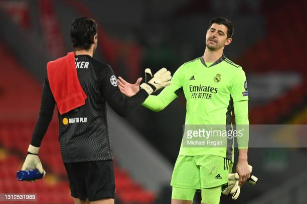 Thibaut Courtois of Real Madrid shakes hands with Alisson of Liverpool following the UEFA Champions League Quarter Final Second Leg match between...