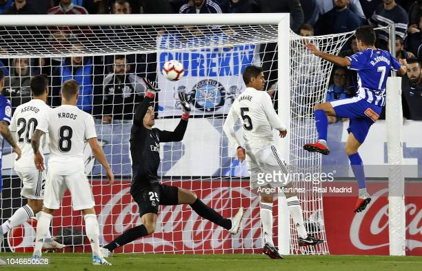 Thibaut Courtois of Real Madrid stops a header from Ruben Sobrino of Deportivo Alaves during the La Liga match between Deportivo Alaves and Real...