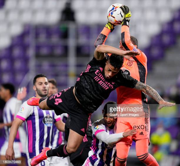 Thibaut Courtois of Real Valladolid battle for the ball with Mariano Diaz of Real Madrid during the La Liga Santander match between Real Valladolid...