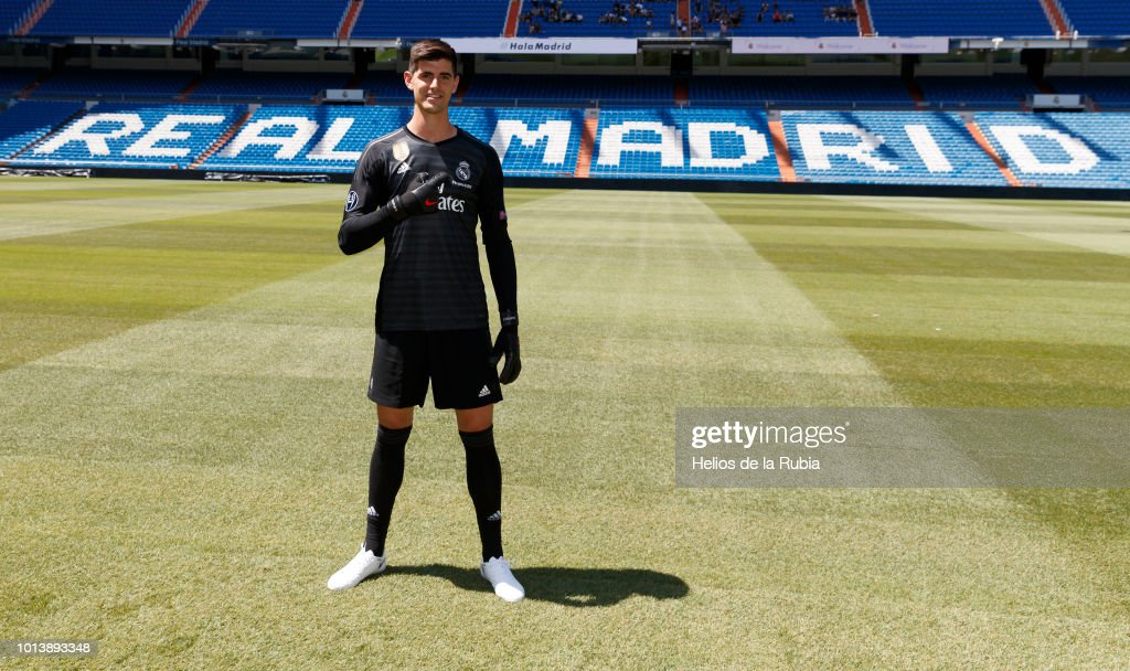 Thibaut Courtois poses during his official presentation at Santiago Bernabeu stadium on August 09, 2018 in Madrid, Spain.