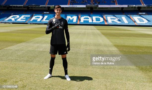 Thibaut Courtois poses during his official presentation at Santiago Bernabeu stadium on August 09 2018 in Madrid Spain