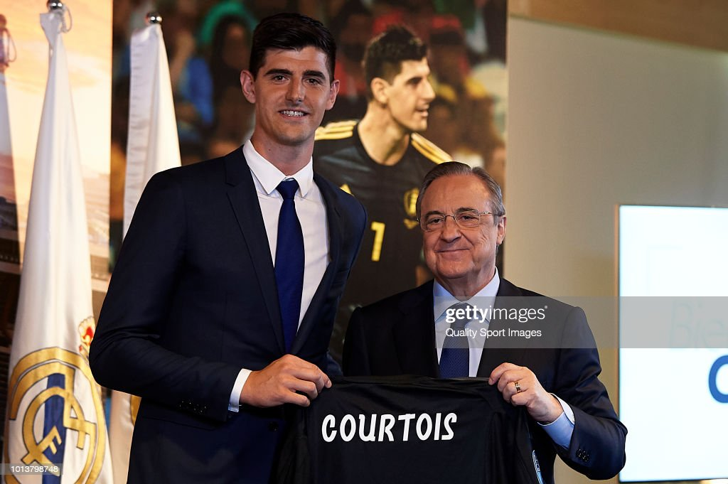 Thibaut Courtois (L) poses with Florentino Perez, President of Real Madrid after being announced as new Real Madrid player during at Estadio Santiago Bernabeu on August 9, 2018 in Madrid, Spain.