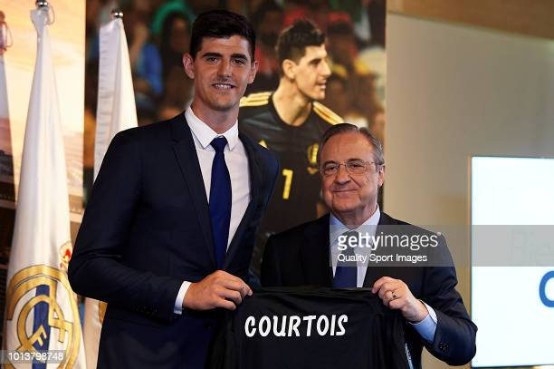Thibaut Courtois poses with Florentino Perez President of Real Madrid after being announced as new Real Madrid player during at Estadio Santiago...