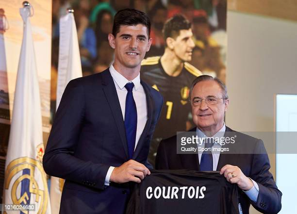 Thibaut Courtois poses with Florentino Perez President of Real Madrid after being announced as a Real Madrid player during at Estadio Santiago...