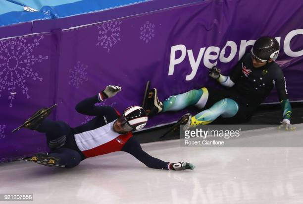 Thibaut Fauconnet of France and Andy Jung of Australia crash out during the Men's Short Track Speed Skating 500m Heats on day eleven of the...