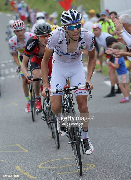 Thibaut Pinot of France and FDJfr defends the Best young rider's white jersey as he leads the group with Tejay van Garderen of the United States and...