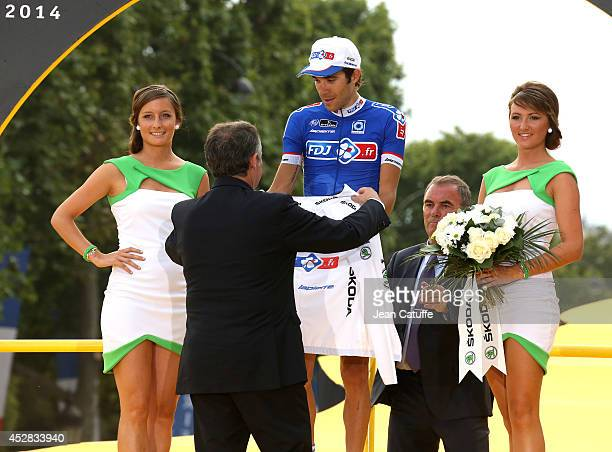 Thibaut Pinot of France and FDJfr receives the best young rider's white jersey after the twenty one and last stage of the 2014 Tour de France a 134...