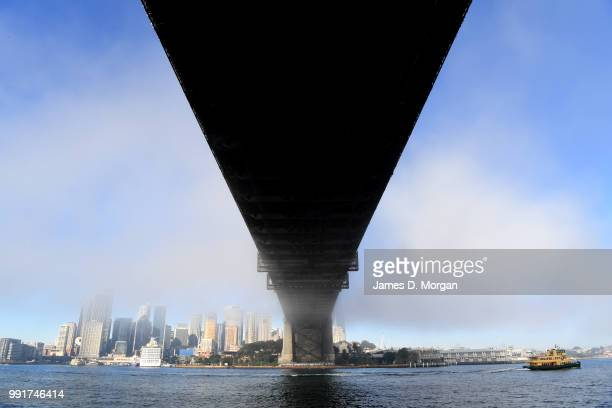 A thick blanket of fog is seen over the Sydney Harbour Bridge on July 5 2018 in Sydney Australia Flights were delayed at Sydney Airport today due to...