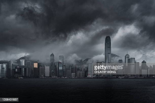 thick cloud and fog shrouds buildings in hong kong - hong kong stock pictures, royalty-free photos & images