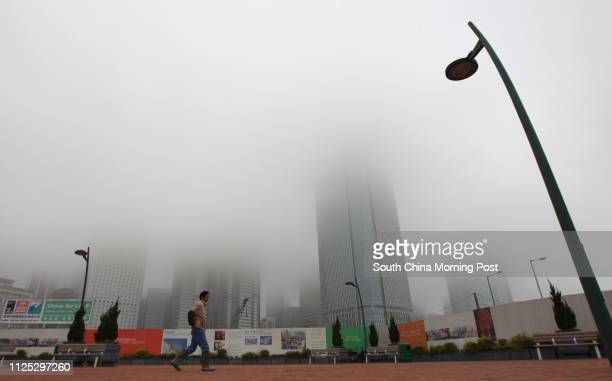 Thick cloud and fog shrouds Central in Hong Kong as heavy snow blizzards are affecting parts of mainland China a warm and humid maritime airstream is...