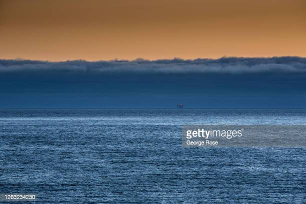 Thick fog bank forms over the water after the sun sets on July 20 in Jalama Beach, California. Because of its close proximity to Southern California...
