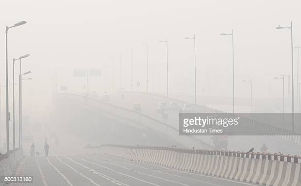 Thick fog engulfs the road with drop in temperature on December 7 2015 in New Delhi India The NCR experienced a cloudy weather with the maximum...