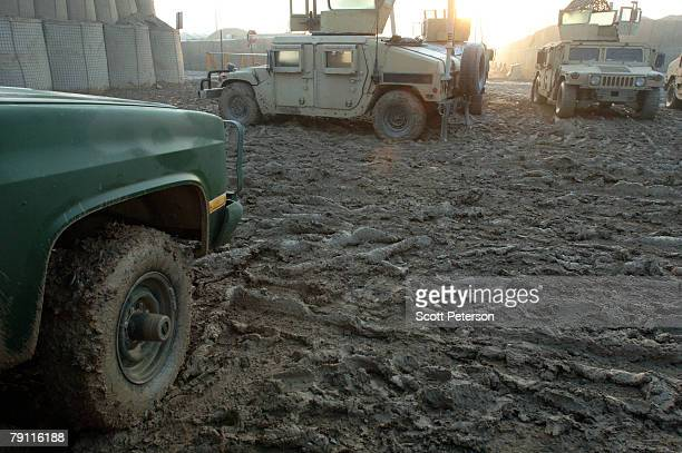 Thick mud covers the ground after heavy rains and subfreezing temperatures at Forward Operating Base Warhorse in Baqubah Iraq on January 13 2008 in...