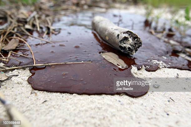 Thick oil is seen washed ashore from the Deepwater Horizon oil spill in the Gulf of Mexico on July 1 2010 in Gulfport Mississippi Millions of gallons...