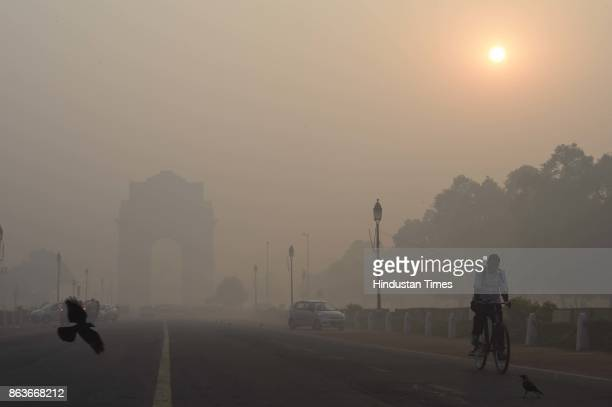 Thick smog and pollution cover India Gate after the Diwali celebration on October 19 2017 in New Delhi India The air quality in various areas of the...