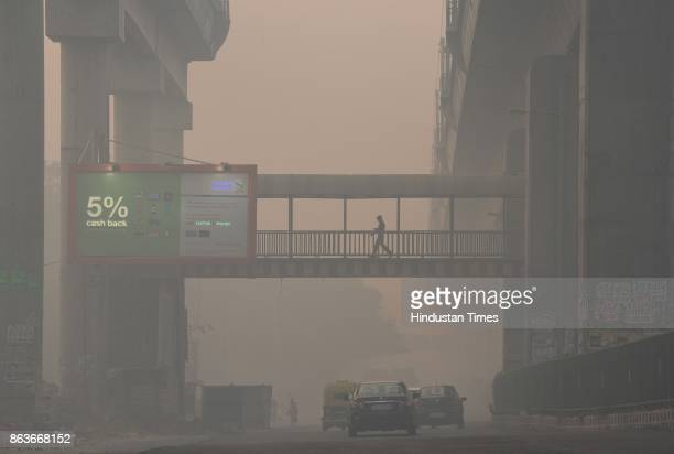 Thick smog and pollution cover the roads a day after Diwali at Moti Bagh on October 19 2017 in New Delhi India The air quality in various areas of...
