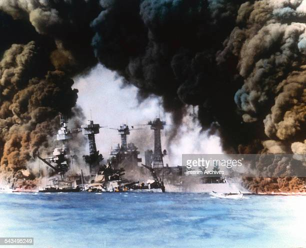 Thick smoke billows up from stricken American warships along battleship row during the Japanese attack on Pearl Harbor Honolulu Oahu Hawaii December...