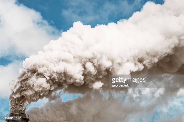 thick smoke coming from an industrial chimney - coal stock pictures, royalty-free photos & images