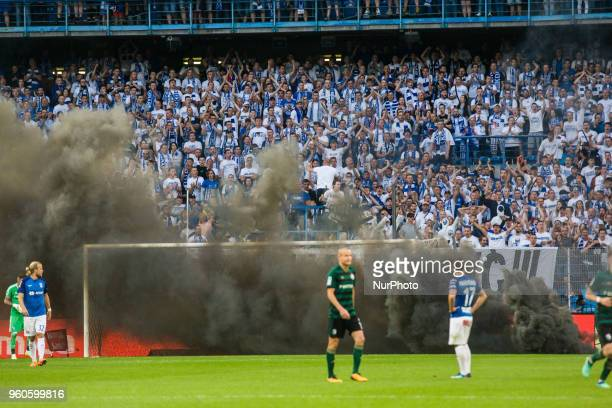 Thick smoke covers field during Playoff Polish League football match between Lech Poznan and Legia Warsaw at Miejski Stadium in Poznan Poland on May...