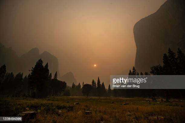 Thick smoke from multiple forest fires shrouds iconic El Capitan right and the granite walls of Yosemite Valley on Saturday Sept 12 2020 in Yosemite...