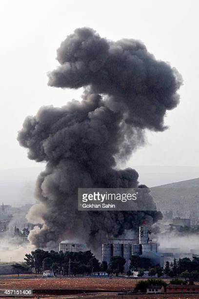 Thick smoke rises following an airstrike by the US-led coalition aircraft in Kobani, Syria, during fighting between Syrian Kurds and the militants of...