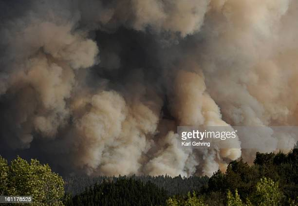 Thick smoke rose from the burning fire south of the Cache La Poudre River at the intersection of Larimer County Road 27 and Colorado Highway 14 west...