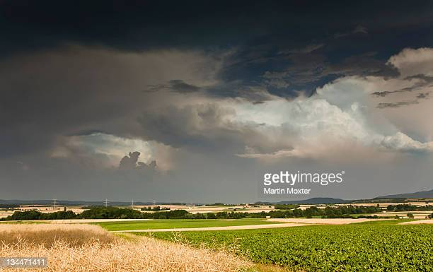 Thick storm clouds gathering over a farming area, Bavaria, Germany, Europe