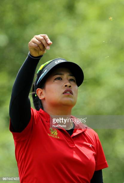 Thidapa Suwannapura tosses a handful of grass in the air before hitting from the 7th tee during the first round of the Marathon LPGA Classic golf...