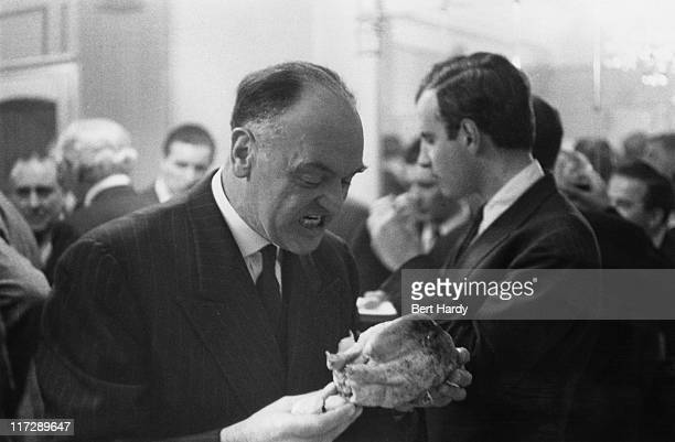 Thief and conman College Harry tucking into a whole roast chicken at a party at Gennaro's restaurant in Soho London given by British gangster Billy...