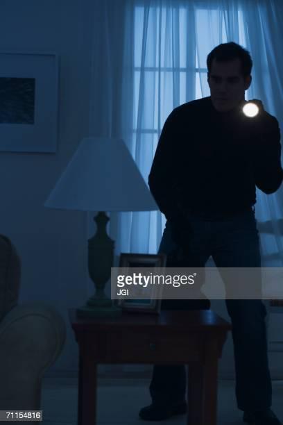 Thief creeping around a room