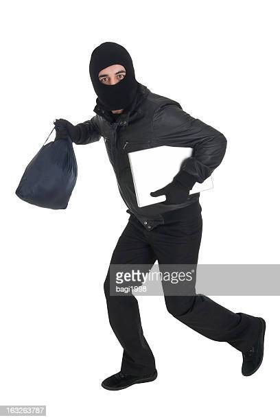 thief dressed in black running - burglar stock pictures, royalty-free photos & images