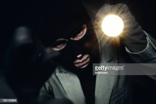 Thief holding a torch