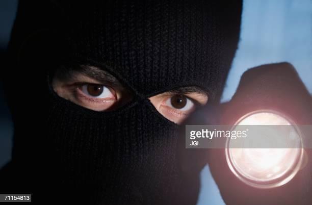 Thief shining his flashlight