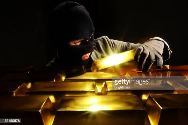 Thief stealing gold bars