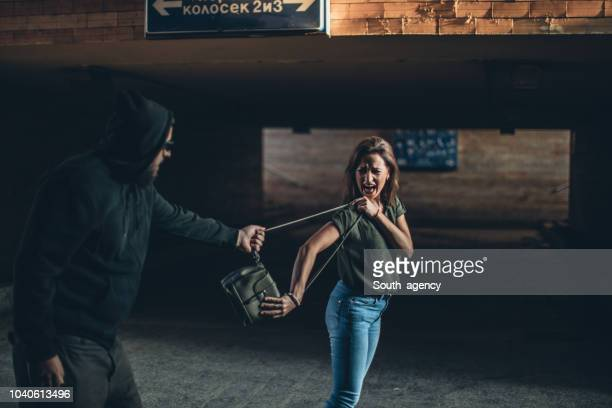 thief trying to steal a purse - south_agency stock pictures, royalty-free photos & images