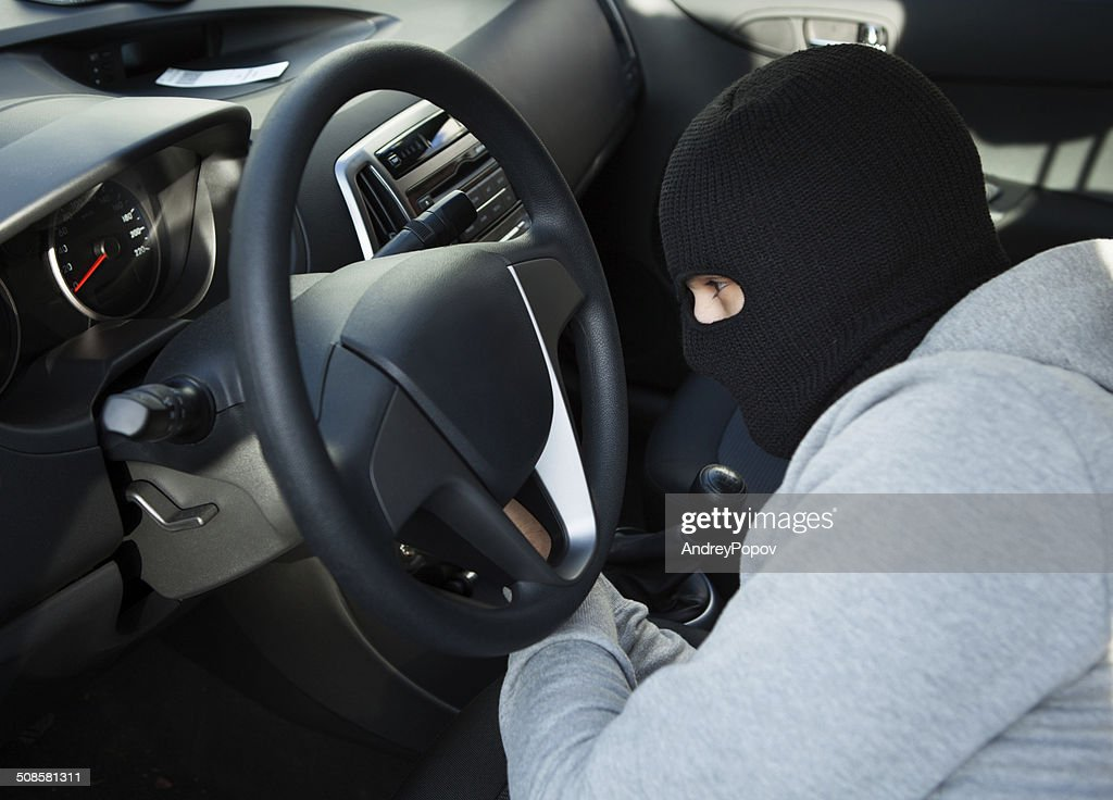Thief Using Screwdriver In Car : Stock Photo