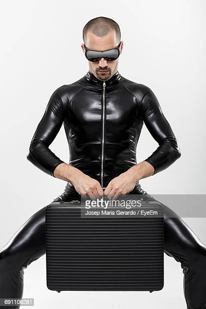 thief with briefcase standing against white background - latex photos et images de collection