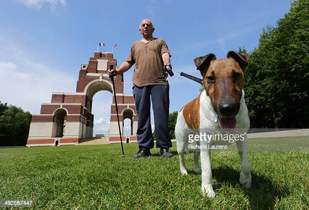 Thiepval, France - May 20 - Jacky Colson walks his dog, Gustav on the grounds of the Thiepval Memorial. The Thiepval Memorial is the largest British...