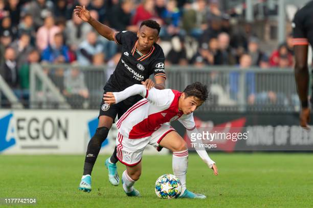 Thierno Ballo of FC Chelsea U19 and Filip Frei of Ajax Amsterdam U19 battle for the ball during the UEFA Youth League match between AFC Ajax and...