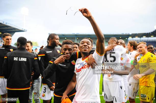 Thierry Ambrose of Lens celebrates the victory with teammates during the Ligue 2 match between Troyes and Lens on May 24 2019 in Troyes France