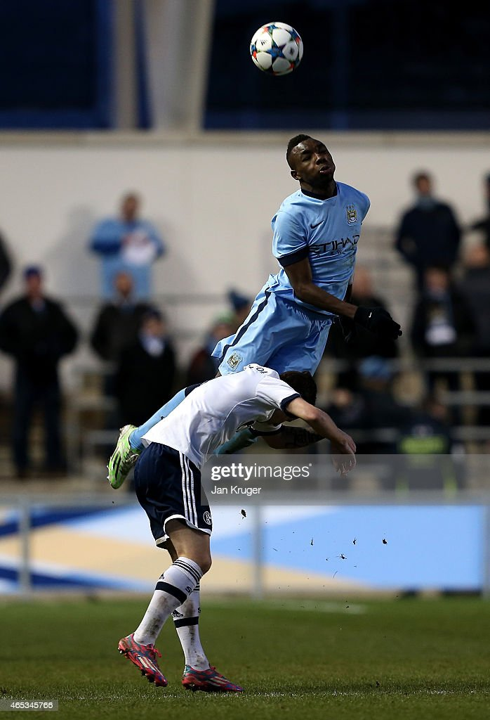 Thierry Ambrose of Manchester City FC battles with Paul Stieber of FC Schalke 04 during the UEFA Youth League Round of 16 match between Manchester City FC and FC Schalke 04 at City Football Academy on February 24, 2015 in Manchester, England.