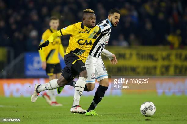 Thierry Ambrose of NAC Breda Brandley Kuwas of Heracles Almelo during the Dutch Eredivisie match between NAC Breda and Heracles Almelo at the Rat...