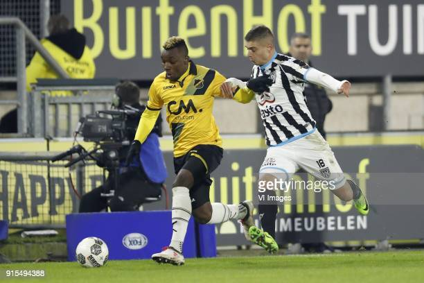 Thierry Ambrose of NAC Breda Kristoffer Peterson of Heracles Almelo during the Dutch Eredivisie match between NAC Breda and Heracles Almelo at the...